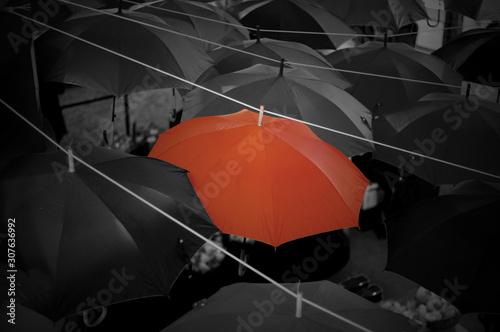 Fototapety, obrazy: Red umbrella on around black umbrella background.