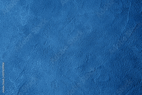 Deep blue textured concrete dark background. Color of 2020 trendy monochrome mockup backdrop - 307639906