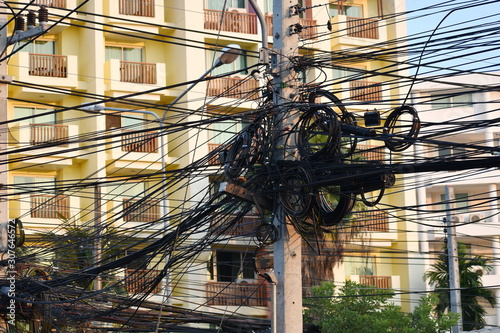 Photo  Power line assembly. Post with electrical wires.