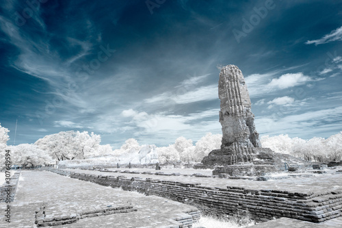 Fotomural  Ruined ancient Buddhist temple and pagoda in infrared photography