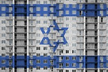 Israel Flag Depicted In Paint Colors On Multi-storey Residental Building Under Construction. Textured Banner On Brick Wall Background