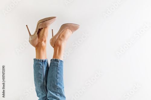 Fotografia Legs with high heels against a white background