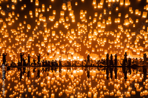 Thai people release sky floating lanterns or lamp to worship Buddha's relics with reflection Canvas Print