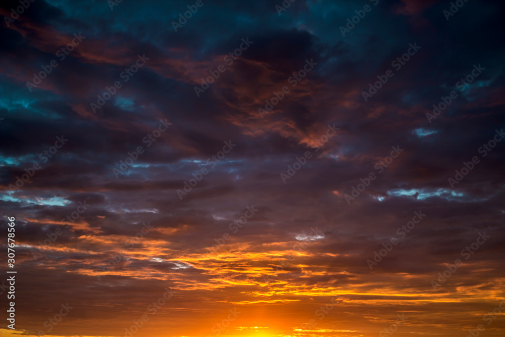 Fototapeta Contract dramatic sky with dark clouds during sunrise