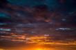 Leinwandbild Motiv Contract dramatic sky with dark clouds during sunrise