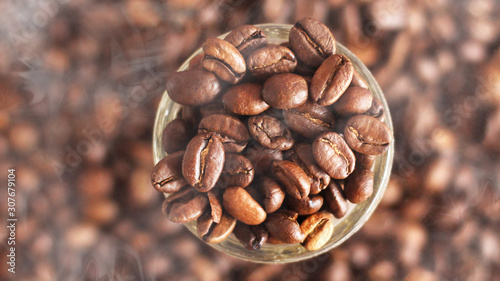 Fotografie, Obraz Coffee beans in the glass bowl. Top view.