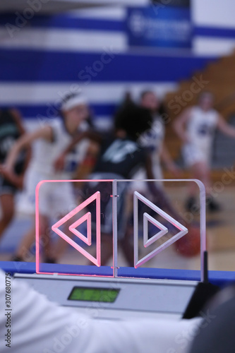 Photo The possession arrow points left during a girls high school basketball game