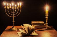 Menorah And Candlestick On Wri...