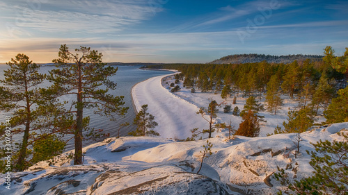 panoramic view from the mountain to the winter beach and forest on the island of Fototapeta