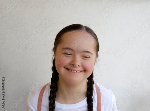 Fotografie, Obraz  Portrait of little girl smiling on background of the wall