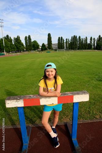 Obraz na plátně  Little girl have fun on the stadium