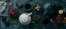 Set Of Black, Green, Fruit And Herbal Tea On Black Stone Background. Tea In Teapot And Cup. Top View. Free Space For Your Text.
