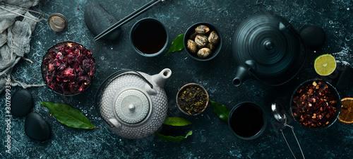 Fototapeta Set of black, green, fruit and herbal tea on black stone background