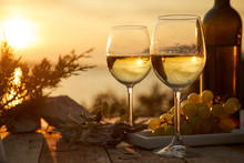 Two Glasses With Wine During Sunset Time