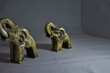 Defocused Porcelain Elephant With Elephant Focused Behind Him