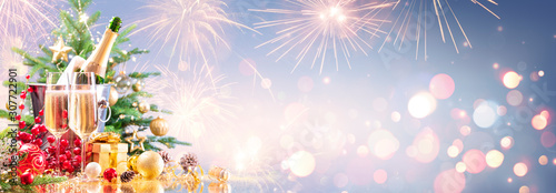 New Year Celebration With Champagne And Fireworks - Golden Lights On Blue Background  - 307722901