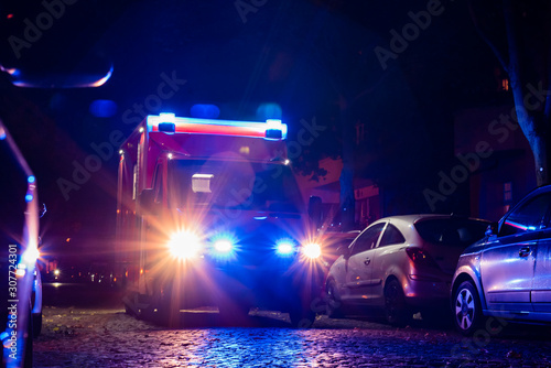 Ambulance at night, blue light, fire department, berlin, germany, out of focus p Canvas Print