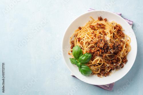 Spaghetti pasta bolognese in plate on concrete background Wallpaper Mural
