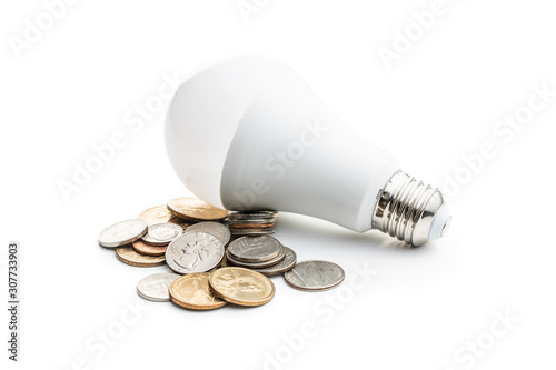 Photo Energy saving light bulb. LED light bulb and dollar coins.