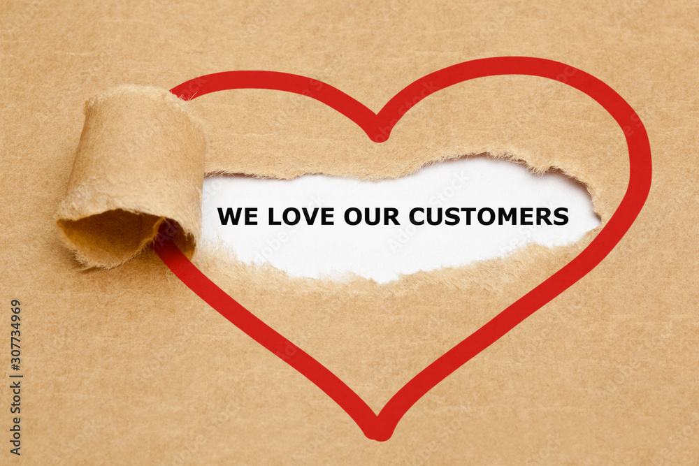Fototapeta We Love Our Customers Torn Paper Concept