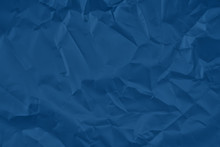 Trendy Classic Blue Colored Textured Background. Crumpled Satine Paper Texture. Flat Lay.  2020 Color Of The Year Trend Concept