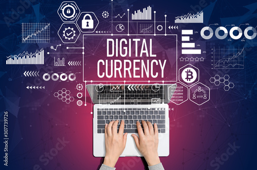 Digital currency theme with person using a laptop computer