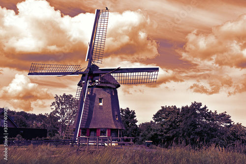 Abstract sepia tone image of traditional old windmill in Edam Holland