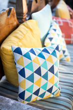 Colorful Throw Pillow On An Cu...