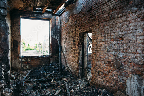 Burned house interior after fire, ruined building room inside, disaster or war aftermath concept Wallpaper Mural