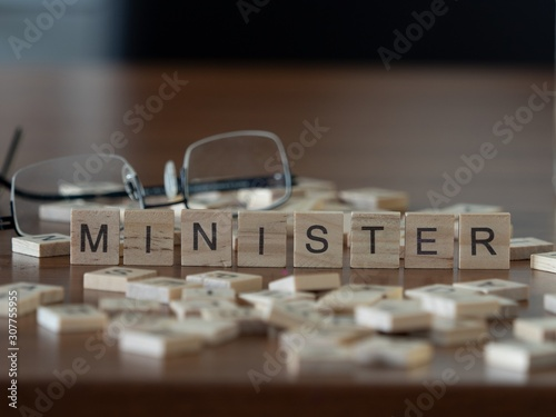 minister the word or concept represented by wooden letter tiles Fototapeta
