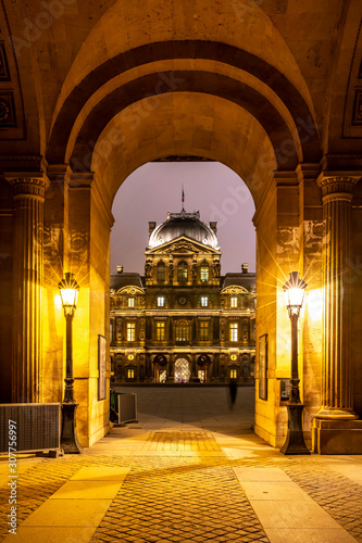Paris, France - December 5, 2019: The famous square courtyard building of the Louvre Museum at night