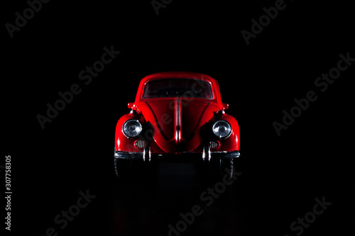 Toy Volkswagen Beetle low key photography Fototapeta