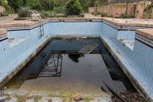 A Dirty And Abandoned Pool Wit...