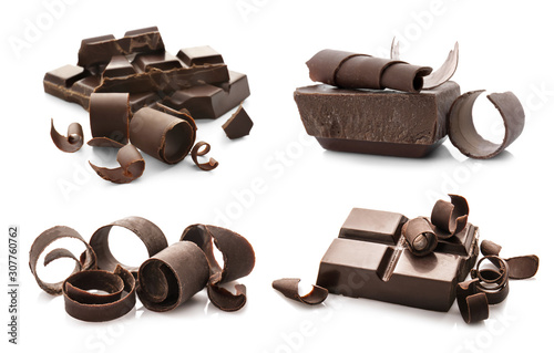 Pieces of chocolate with curls on white background Wallpaper Mural