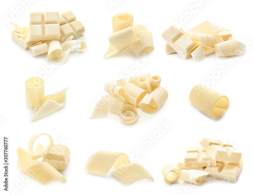 obraz lub plakat Pieces of chocolate with curls on white background