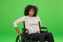 Charming Portrait Of Happy African American Woman Sitting In Wheelchair