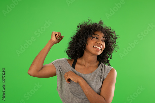 Photo  A beautiful happy African American female dancing on greenscreen