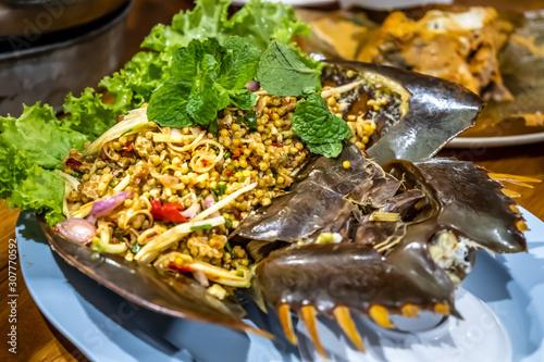 Fényképezés Spicy eggs pimp salad chilli food thai style with Horseshoe crab.