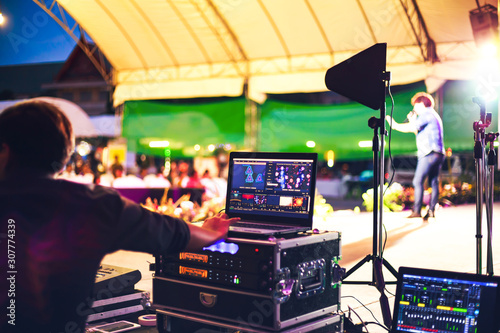 Sound engineer control music sound and light in concert near the stage Canvas Print