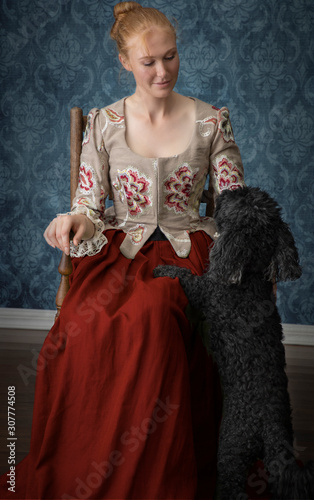 Carta da parati Red-haired 18th century woman wearing an embroidered bodice