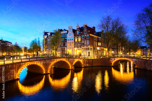 Valokuvatapetti Canals of Amsterdam during twilight in Netherlands