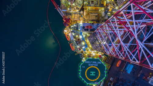 Fototapeta Aerial view offshore jack up rig  at night, Offshore oil rig drilling platform