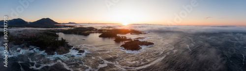 Obraz Ucluelet, Vancouver Island, British Columbia, Canada. Aerial Panoramic View of a Small Town near Tofino on a Rocky Pacific Ocean Coast during a cloudy  and colorful morning sunrise. - fototapety do salonu