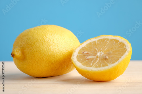 Lemon on wooden table and blue background