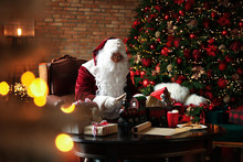 Santa Claus Making New Toy For...