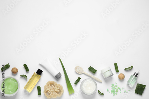Fototapeta  Flat lay composition with aloe vera and cosmetic products on white background