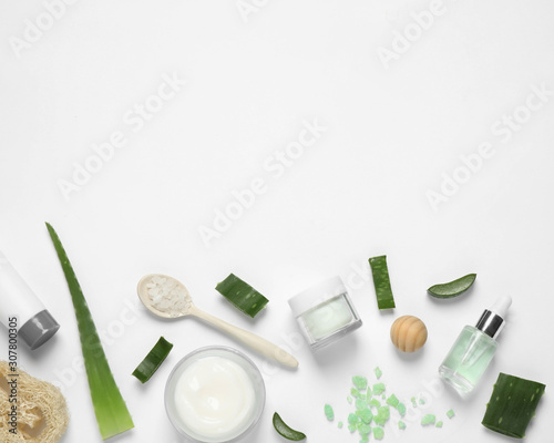 Obraz na plátně  Flat lay composition with aloe vera and cosmetic products on white background