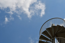 Blue Sky And Metal Spiral Staircase
