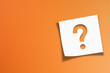 canvas print picture - Note paper with question mark on orange background