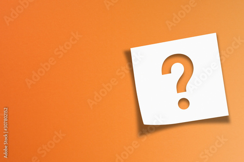 Photo Note paper with question mark on orange background